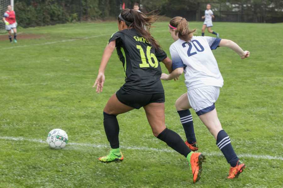 Kimberly Santos '18 fighting for a loose ball - Photo by David Barron