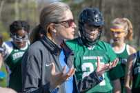 Coach Kyla Graves talks strategy with her team. Photo by David Barron.