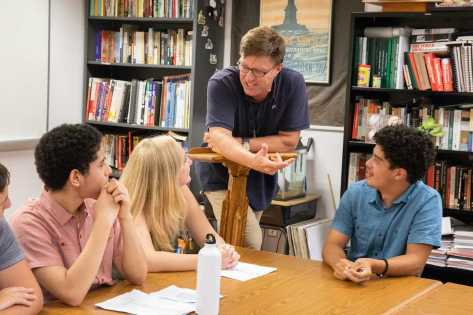 History teacher Ted Barker-Hook engaging with his students. Photo by David Barron.