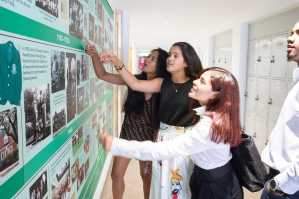 Students checking out the new history wall. Photo by David Barron.