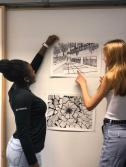 Ayanna Jefferson '22 and Astrid Voss '22 looking at their drawings. Photo By Sita Alomran '19