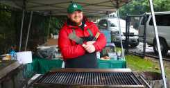 """Brian """"Coach Chef"""" Roman grills up some burgers for fans to enjoy. Photo by Michelle Levinger '19."""