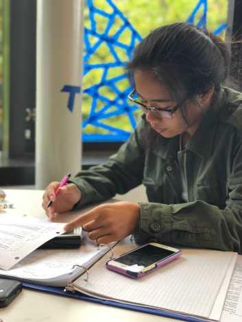 Marianne Alagos '21 doing her homework. Photo By Sita Alomran '19