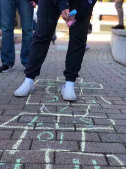 Student using chalk to design the pathway. Photo By Sita Alomran '19.