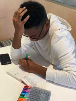 Miles Best '20 working on his English annotations. Photo By Sita Alomran '19.
