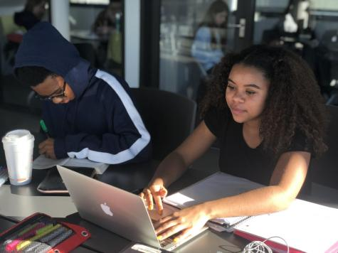 Miles Best '20 and Sade Latinwo '20 working on their English project. Photo by Sita Alomran '19.