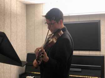Simon Amaya Price '22 practicing playing the violin. Photo By Sita Alomran '19.