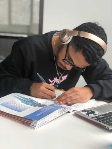 Steven Ramsden '19 working on his anatomy work book. Photo By Sita Alomran '19.