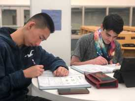 Leo Wen '21 and Ben Kaplan '21 working together on there mandarin home work. Photo By Sita Alomran '19.