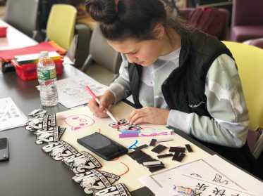 Hannah Ahearn '20 coloring. Photo By Sita Alomran '19.