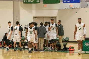 Gianni Thompson '21 gets ready to take the court with his team, away at Andover at Babson. Photo by David Barron.