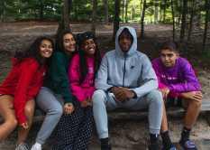 Campers Tahina Triaz-Lizama '22, Sylvia Tejada '23, Behare Goshime '22, Jayden Okorougo '22, and Harrison Teschke '22 watch their classmates shoot hoops during free time.