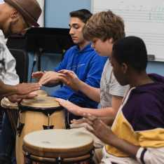 Marcus Santos teaches Michael Young '23 a Maculele rhythm.