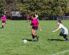 Kaylee Little '23 dribbles toward the opponent's goal.