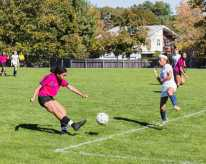 Kaylee Little '23 crosses the ball past an opposing player.