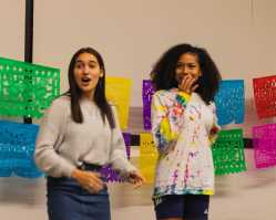 Sylvia Tejada '23 and Kaylee Little '23 are impressed with the crowd's dancing ability.