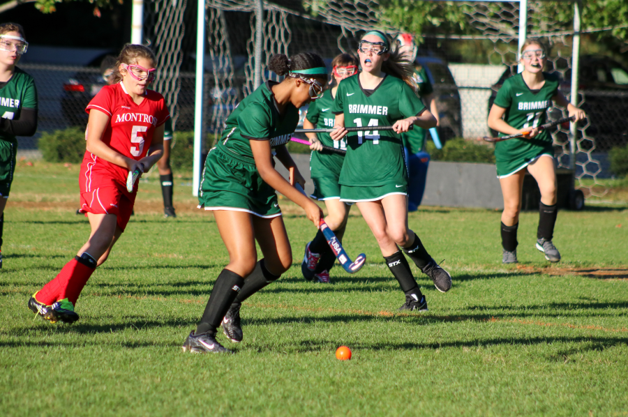 Behare Goshime '22 takes possession of the ball, as her team offers support. Photo courtesy of Brimmer and May School.