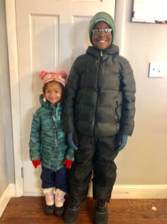 Middle School Head Carl Rapisarda-Vallely's children were prepared to play in the snow.