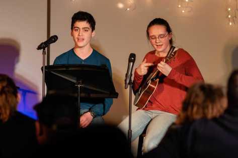 Zakkai Mares-van Praag '22 sings a song while Sophia Spring '22 plays on her ukulele.