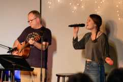 Senior Anja Westhues '20 sings a song, accompanied by her father, Jukka Westhues, on the guitar.