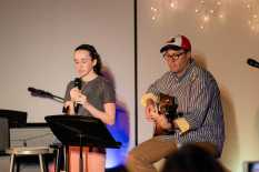 Libby Foley '20, accompanied by history teacher, Ted Barker-Hook on the guitar, sings a song.