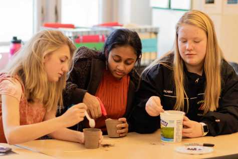 Students plant seeds in the hands-on class,