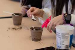 """Students plant various seeds in """"Act Locally, Impact Globally: The Power of a Community Farm""""."""