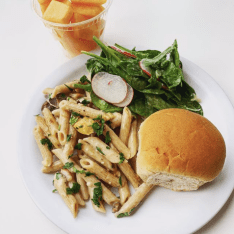 Pasta Primavera, Spinach Salad, Dinner Roll and Cantaloupe. Photo courtesy of the @brimmer_eats Instagram.