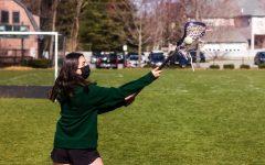Rachel Sobel '23 catches a lacrosse ball.