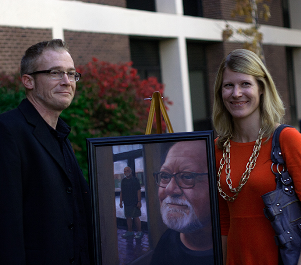 "Family of the late Sanford ""Mark"" Trojan with his painted portrait."