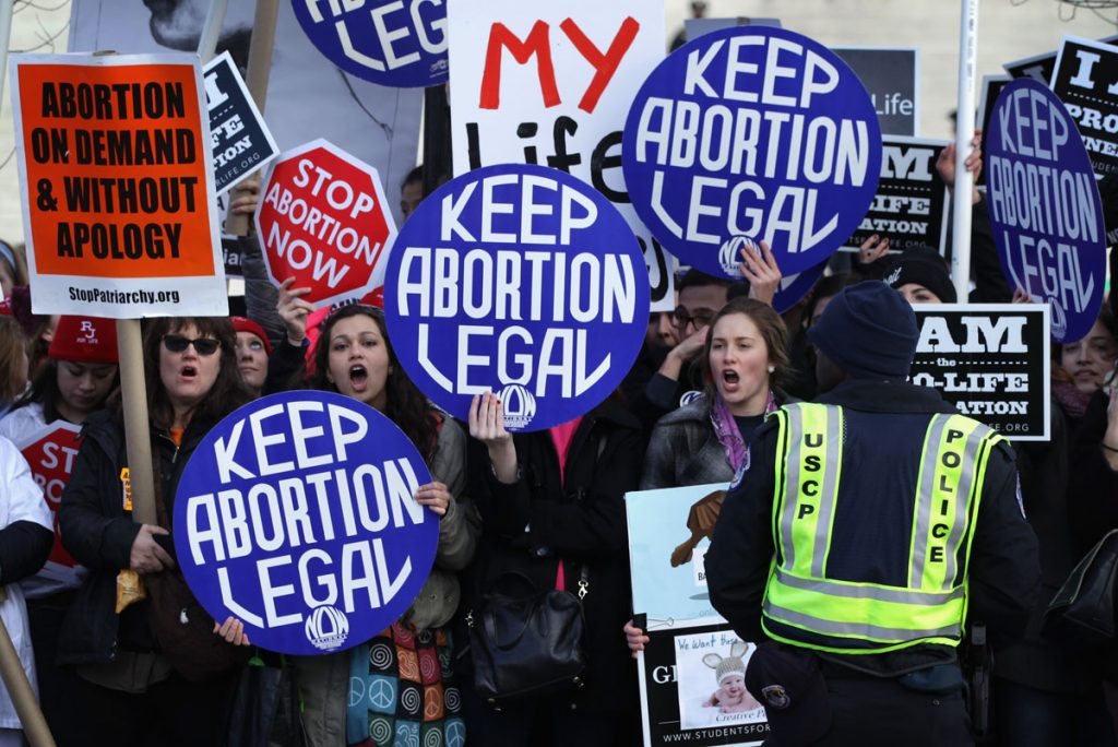 WASHINGTON, DC - JANUARY 22: Pro-choice activists shout slogans before the annual March for Life passes by the U.S. Supreme Court January 22, 2015 in Washington, DC. Pro-life activists gathered in the nation's capital to mark the 1973 Supreme Court Roe v. Wade decision that legalized abortion. (Photo by Alex Wong/Getty Images) ORG XMIT: 533840441
