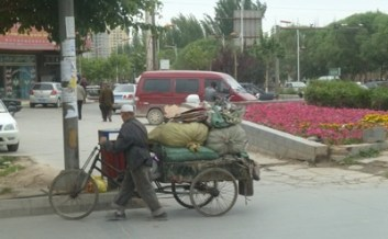 Goods being moved in the midst of city traffic