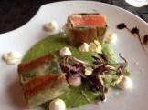 Salmon, zucchini puree with radish flowers