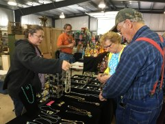 Connie Wince assists customers as they peruse her hand made jewelry in Kingwood, W. Va. on Oct. 2. The Buckwheat Festival offered various stands and rooms for visitors to purchase local art pieces.