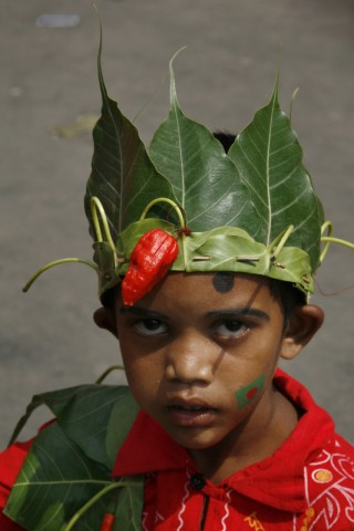 New years decoration - a little boy with a crown of leaves. Image by Abu Ala. Copyright Demotix