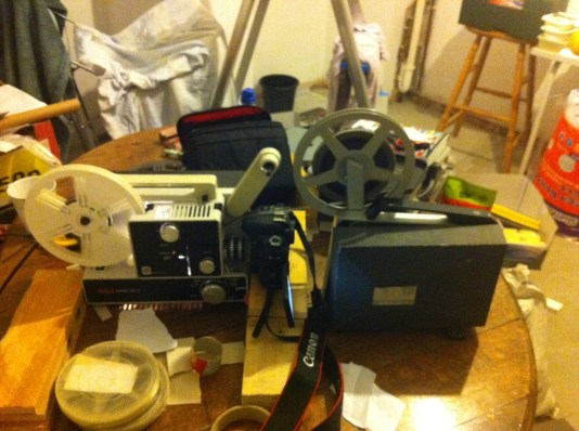 Using a spool from one projector and projecting with the other, due to the positioning of the camera not leaving room for longer films.