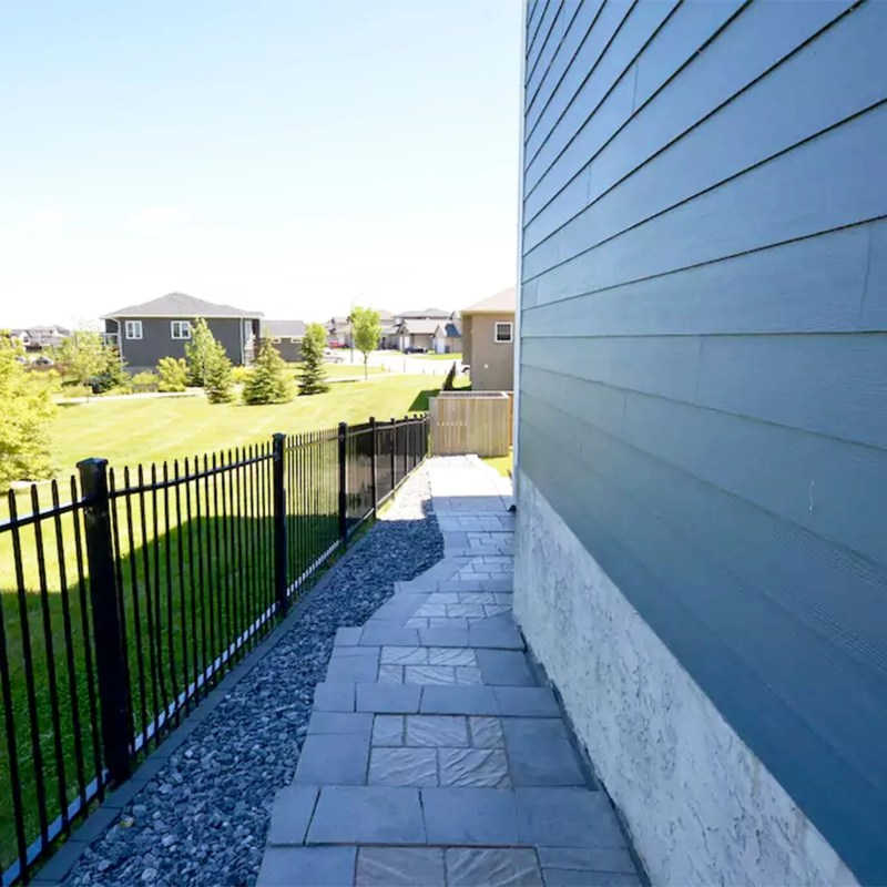 Private walkway around the side of the home leading to the suite