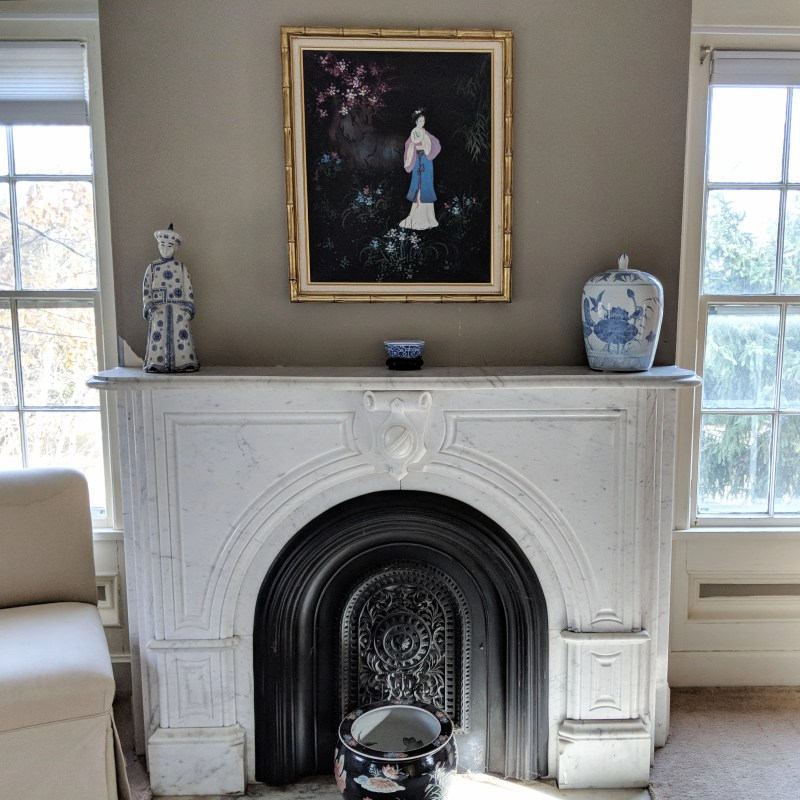 fireplace with painting
