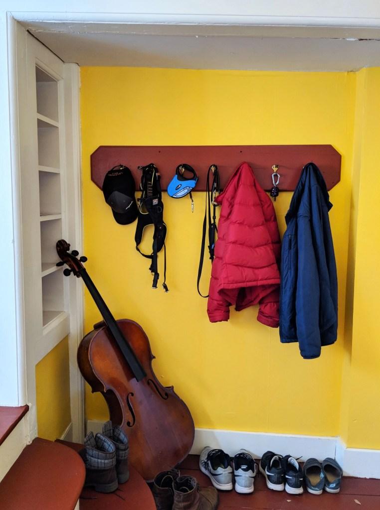 coats and shoes in doorway