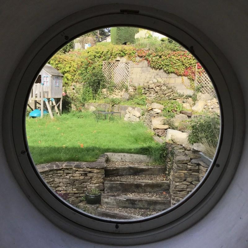 Circular window looking upon garden