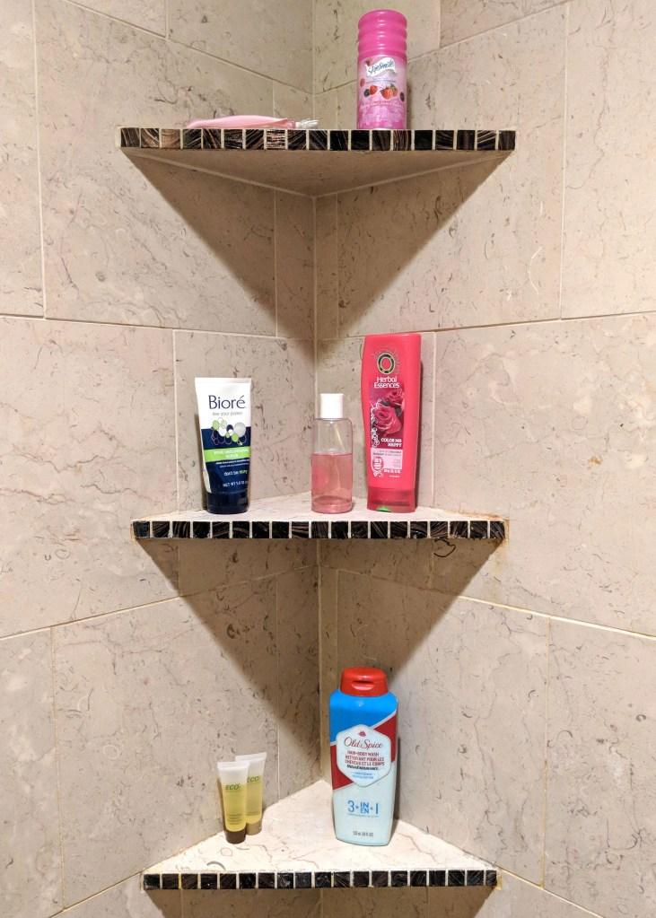 three shelves inside a shower