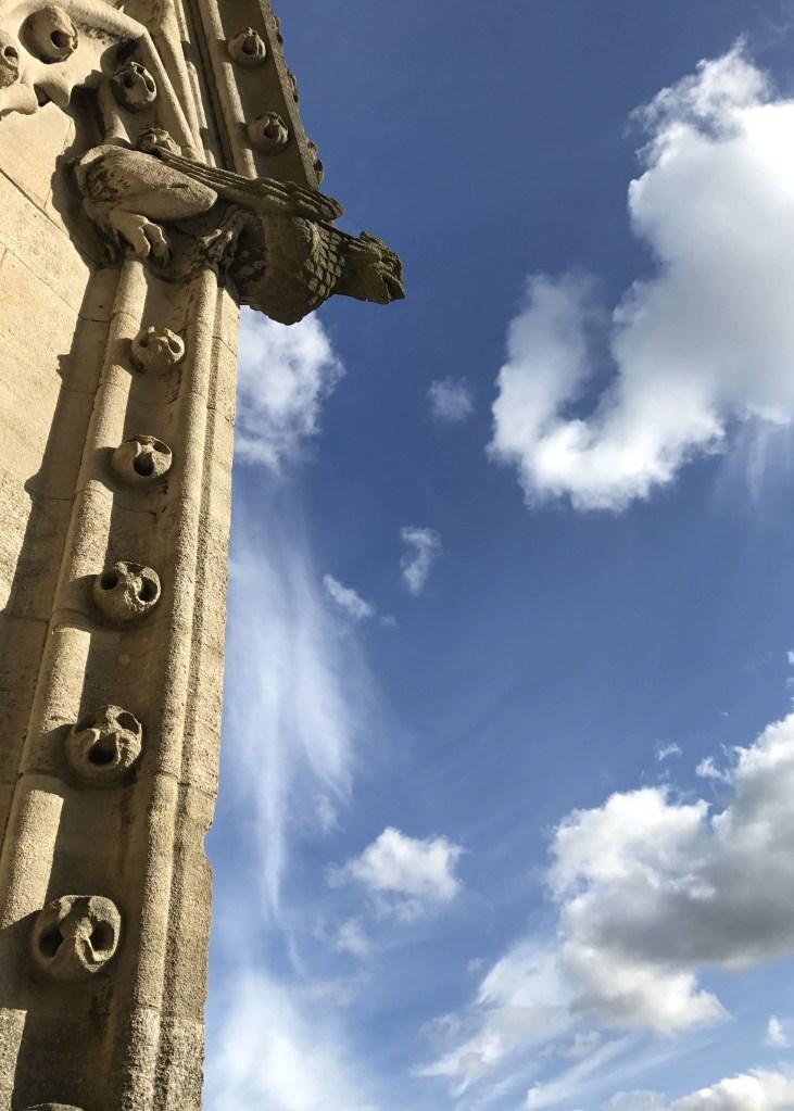 gargoyle against blue sky in Oxford, England