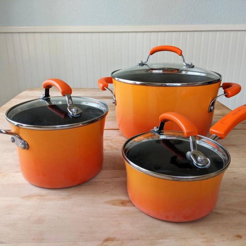 three orange pots by Rachael Ray