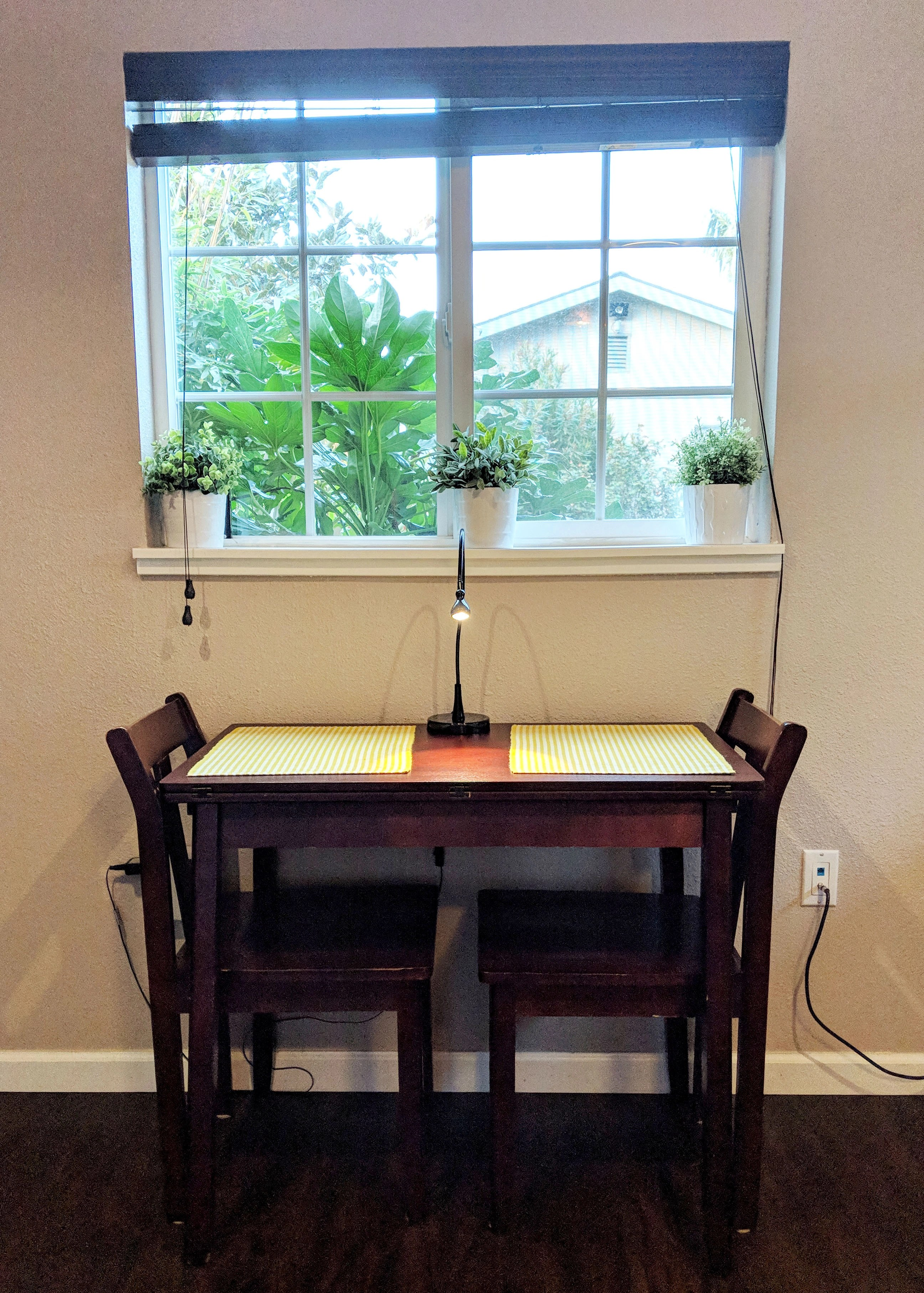 tiny table in front of window with two chairs