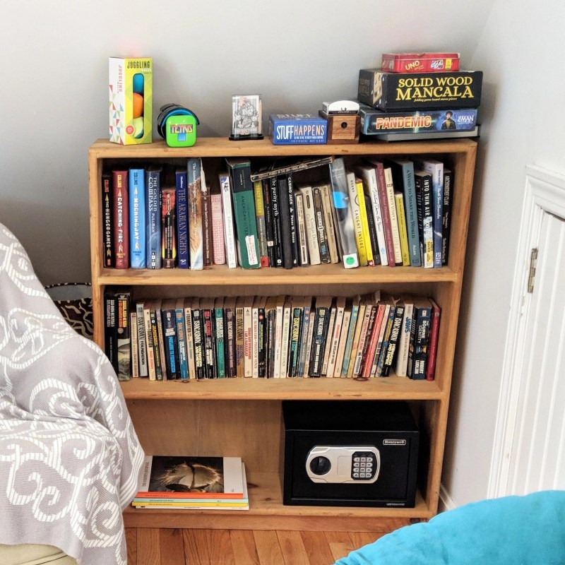 Airbnb shelf with games and books