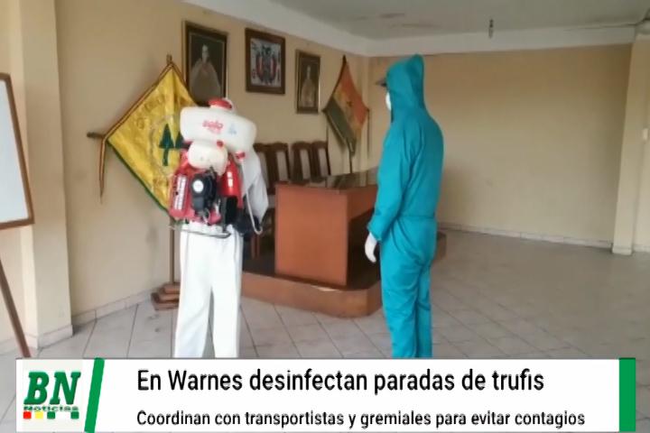 En Warnes desinfectan las paradas de trufis para evitar contagios