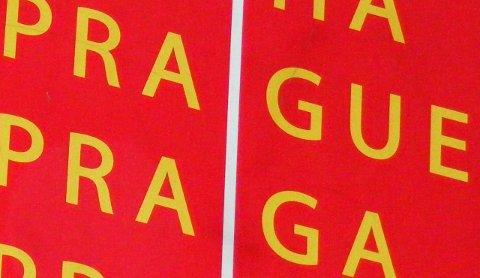 Detail from a sign reading Praha, Prague, Praga, Prag.
