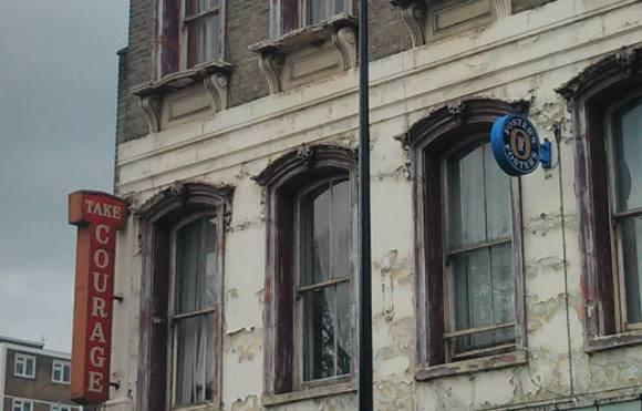 Pub, South London: 'Take Courage'.