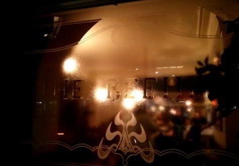 Pub window, night.