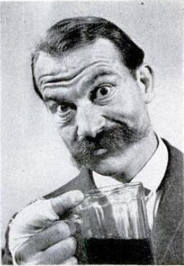 A moustachioed man with a pint glass.